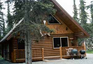 The 24' x 28' Kenai Prince w/1/2 loft, 6' covered deck steel roof, 2 bedrooms, 1 bath & living room cathedral ceilings blends with any landscape.