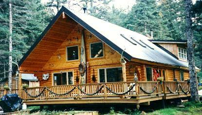 """The 2,000 sq. ft. Muskomee Bay Lodge was designed, made & supplied for the owner in 8"""" """"Superior Logs"""".  From the wood foundations to the metal roof with 1/2 loft, skylights, 1 x 6 T & G knotty pine trim, log stairs & 12' covered front deck."""