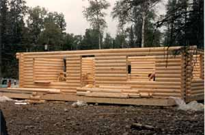 """The 4-man framing crew assembled this 26' X 36' Juneau pre-cut 8"""" Superior Logs package in 14 hours including drilling the 2 X 8 top plates for our 5/8"""" all thread bolt system. Many times husbands & wives assemble their own log packages. Our Superior Logs are very dry (19% or less moisture content) which saves stacking time & shipping costs."""