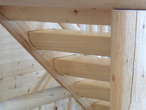 "11"" half-log step treads with 10"" half-log stair stinggers"