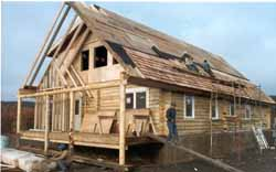 """3,000 SQ. FT. Pilot Station City Offices in our pre-cut 8"""" Superior Logs were erected within 15 hours by villagers. Complete exterior shell package, including foundation, was built in 3 weeks."""