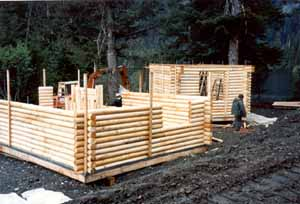 """An Alaskan Native Village Corporation built these remote 6"""" Superior Logs cabins. They use them for hunting & fishing at a remote Alaskan lake. We provided the complete weathered-in shell packages. They assembled 6 cabins & the lodge using their own labor & our easy to follow instructions."""