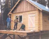 """Our 16' X 24' Cheechako III cabin is located on a remote Alaskan lake & was built by the owner's family. Our 6"""" Superior Logs were very light & assembled quickly. All materials were taken in by snow machines during the winter & assembled the next Spring. Cool get away!!"""