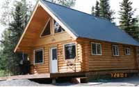 """Our 20' X 26' Kenai King cabin is located on the Kenai River. It will become a guest cottage when the final home is built on the river. Our 8"""" Superior Logs are staggered to support the roof system. All openings are pre-cut to fit the doors & windows provided. The owners & friends spend a great deal of time on the river & enjoy this cabin a great deal. Will they ever want to build the final home? You bet!!"""