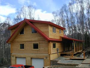 "3-story pre-cut 10"" Superior Logs home"