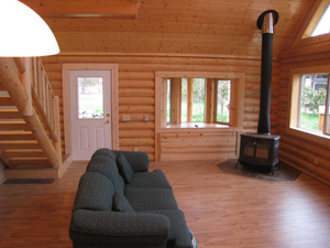 Great room, wood stove, log stairs, T&G ceiling & hardwood floor