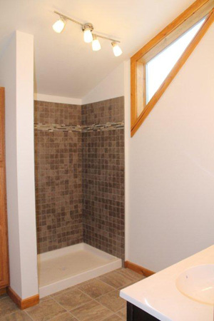 Natural light to custom tiled shower in loft