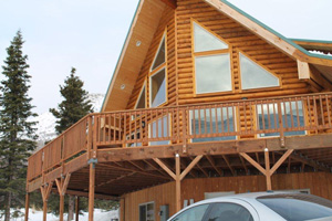 """Gorgeous prow front with 8"""" half log siding and beautiful windows"""