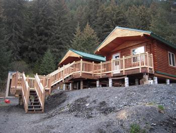 "Chenega Village 6"" pre-cut log cabins built by Chenega."