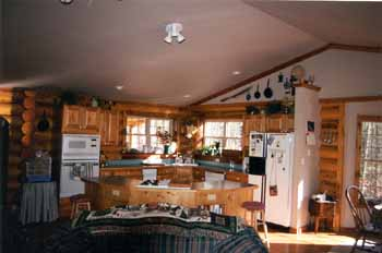 Kitchens can be open country or formal, gourmet or kitchenette. They can be designed to accommodate your needs & desires using our uniform, precision milled Superior Logs. These conventional scissor trusses create a wonderful cathedral ceiling with sheetrock & cedar trim accents. We supply large quantities of 1 X 6 T & G #2 knotty pine trim for ceilings.