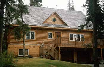 "This 2,300 square foot custom Anchorage Hillside log home blends beautifully with it's surroundings. Our 8"" Alaskan Made Superior Logs were delivered the day the subfloor was finished!!!"