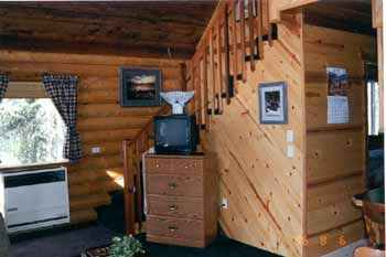 "This recreational cabin has 1 X 6 T & G #2 knotty pine trim for ceilings & walls. We supplied the complete weathered-in shell package & 8"" Superior Logs but we DID NOT supply the Halibut tail mount!! The owners took care of that item themselves!!"