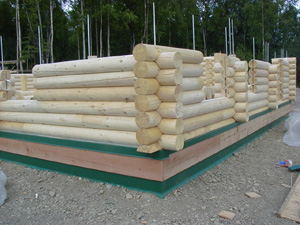 """Pre-cut 10"""" Superior Logsgoing up- Note metal log at floor and foundation flashes we provide."""