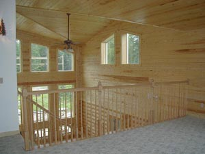 "View from loft showing 8"" Superior Logsn& our 1X6 T&G #2 knotty pine interior trim"