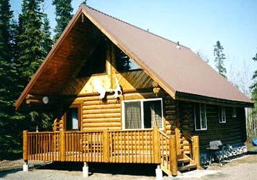 """This 8"""" """"Superior Logs"""" 20' x 26' Kenai King shell package with 1/2 loft, 6' covered porch & metal roof was built in 7 days with 3 men"""