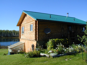 "8"" Superior Log home on a daylight basement with log-sided gable ends."