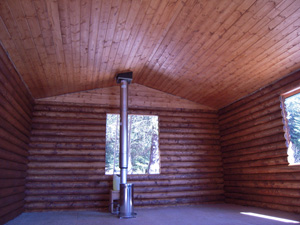 """A remote 6"""" log pre-cut cabin ready for the windows we supply."""