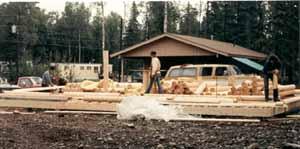 "Superior Logs are usually placed on the subfloor for stacking. The logs are spread to distribute the weight. Carefully open each bundle, spread the logs & place the shorter logs on end with the numbers up for easy access. Our 5/8"" X 40"" all thread bolt system at 4' O. C. or less in the running walls, 12"" O. C. or less at each opening & centered in each saddle corner starts at the foundation & goes through the 2 X log top plate. We provide a foundation bolt plan with each package."