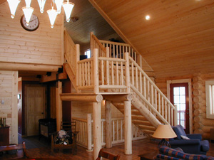 Great log stairs & accents. We made the stair treads,  stringers & posts; handrails by others.