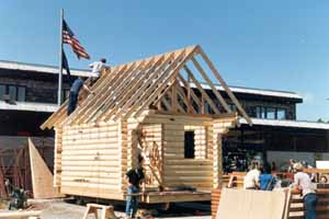 In the '80s, we made pre-cut Superior Logs packages for Spenard Builders Supply (SBS), a very large Alaskan material supplier. The SBS store people erected 12' X 16' cabins over a weekend in front of their stores for display. Superior Logs adapt to most any foundation, floor & roof systems. We usually stagger the top courses & extend the glue lam beam ridge to carry roof overhangs. The SBS people had lots of FUN!!! That's the store manager on the rooftop.
