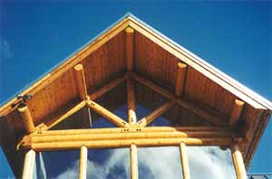 "We provide accent logs if you want a log truss, roof purlin & ridge beam ""log look"". These 10"" Superior Logs have 1"" slabs on top to nest against conventional roof systems. There is a glue lam beam ridge covered by our Superior Logs. We supplied the truss gussets, bolts & raw logs. The builder created the trusses in the field. We DO NOT make log trusses. We only supply the materials."