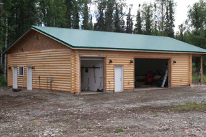 "8"" half log sided frame garage with saddle corners."