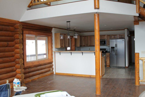 Open kitchen & dining areas compliment logs
