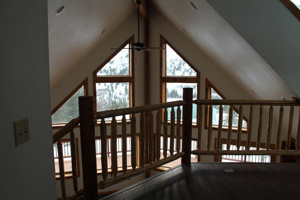 Great Alaska mountain views through our prow front custom window package. Our logs heat very well. This home made 5 Star Energy, ceiling fan to circulate warm air down again. View from open loft