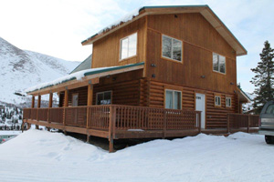Great Alaskan mountain home with covered side decks.
