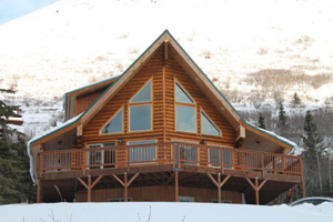 "This 8"" log home ade 5 Star Energy. It has a  12' front deck."