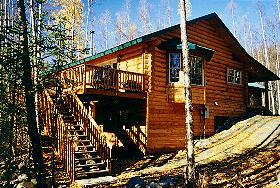 The Beluga also features a bay window nook, corner river fireplace, 2 ½ baths, 3 bedrooms PLUS an upper stairs master suite with recessed lighting & a master bath with skylight, atrium, dual showers, jetted tub, his & hers walk-in closets. The back deck overlooks Peters Creek. What a way to enjoy the Alaskan experience!!