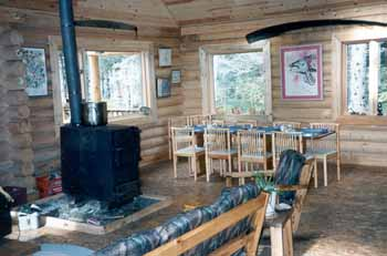 This remote lodge has wood spindle chairs for the fishing & hunting guests. The large barrel stove heats the lodge very well. The lodge has 1 X 6 T & G #2 knotty pine trim for ceilings & walls.