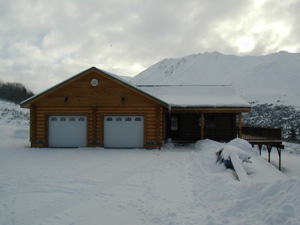 "10"" Superior Logs home w/ 2 car garage set in the mountains."