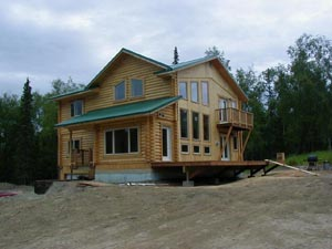 "8"" Superior Log 3-story home w/ full logs,log siding and T&G."