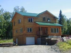 Custom log home with full basement, board N batt, arctic entry, logs & log siding.