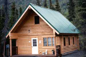 The State of Alaska 20' x 24' Coopers Landing Caretaker's cabin at the Kenai Lake bridge was created to accent the natural surroundings.